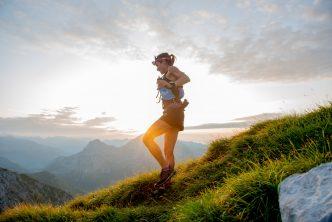 A female ultra runner running through the mountains